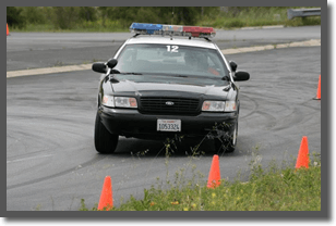 An officer practices emergency vehicle operations