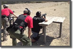 Officers firing their weapons on the range